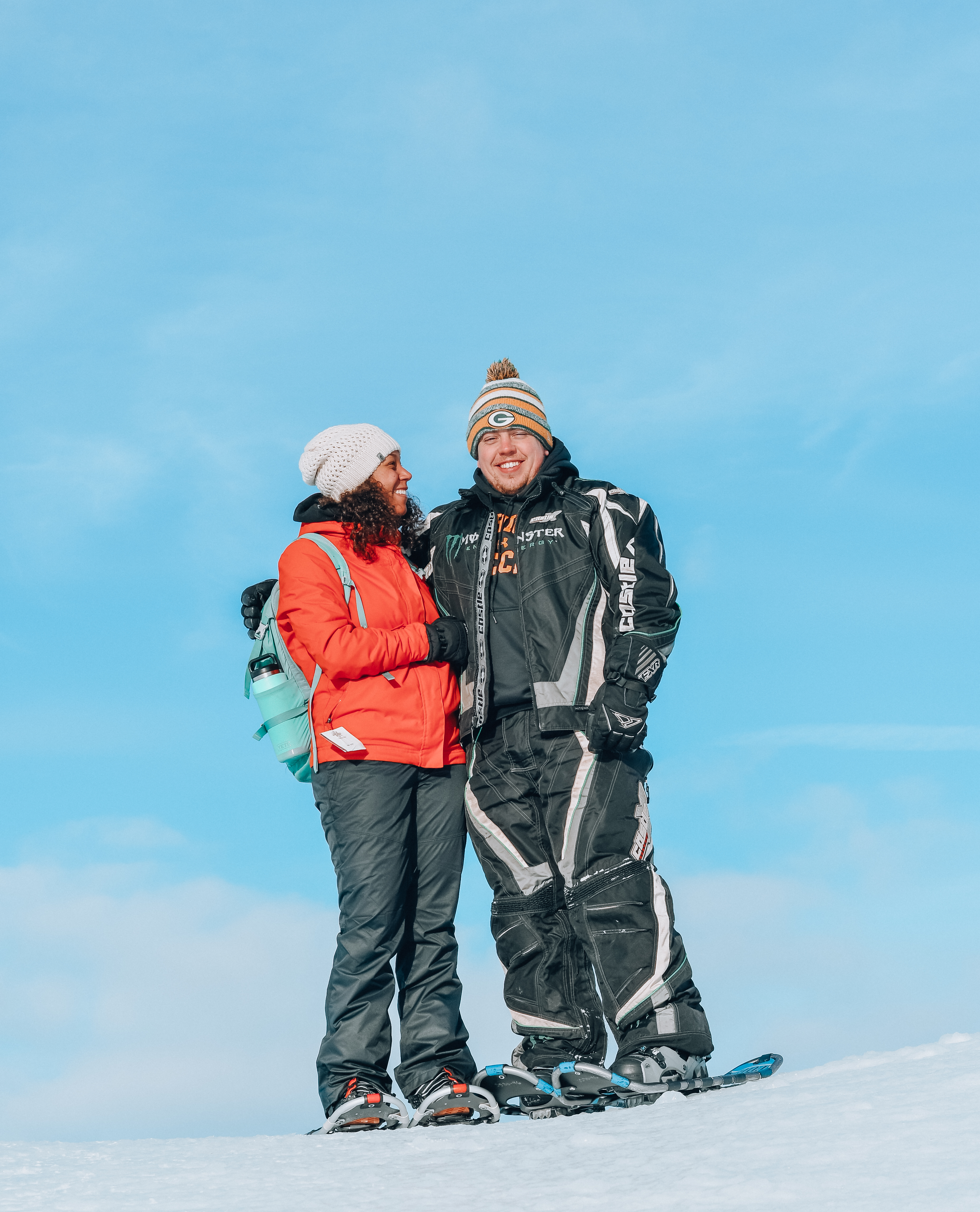 Sean and Q together in snowshoes on top of ice dune.